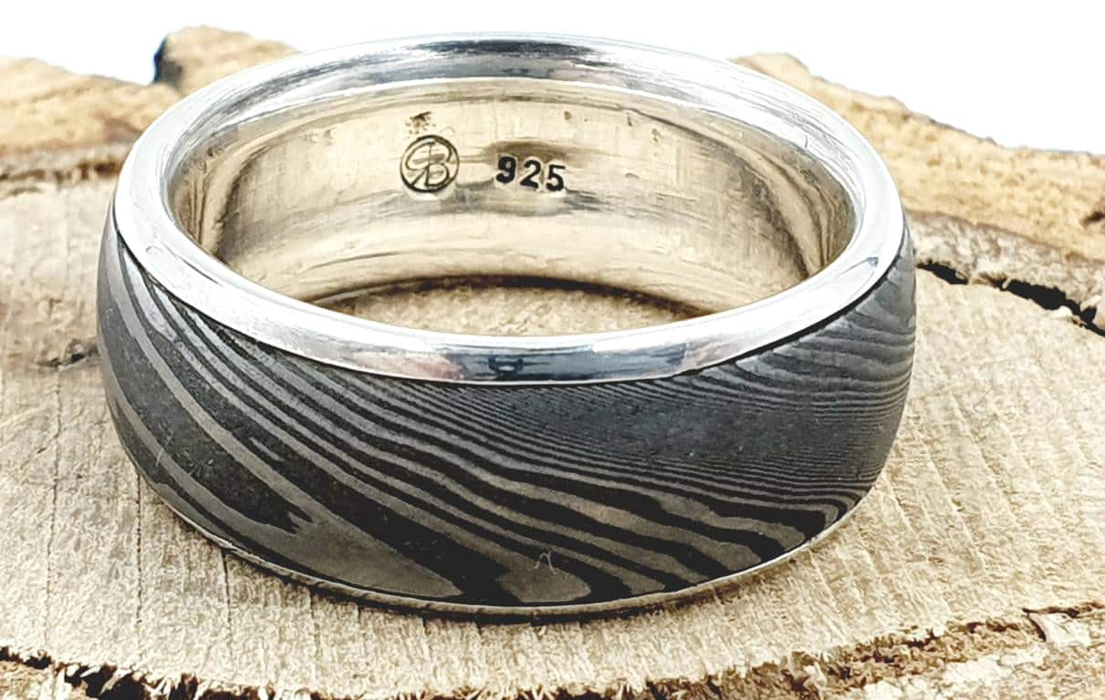 Damaszener Stahl kombiniert mit massivem Silber personalisierbar