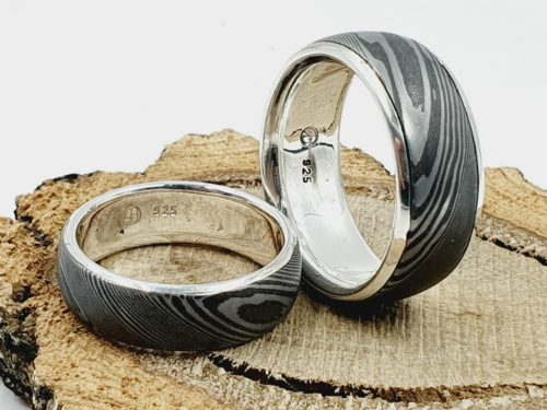 Partner / Eheringe aus Damaszener Stahl kombiniert mit massivem Silber / personalisierbar